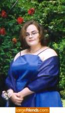 This is a picture of myself in my prom gown. The night was gorgeous. Right now, my hair is down past my shoulders, and I no longer wear glasses.
